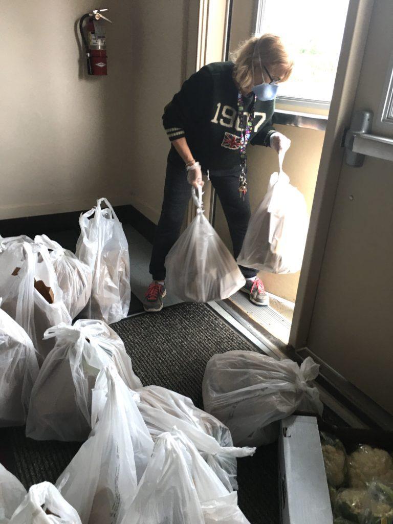 volunteers donating to food pantry in the hamptons coronavirus