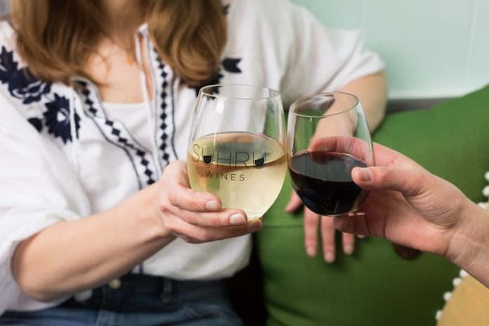 people cheers with red white wine at home