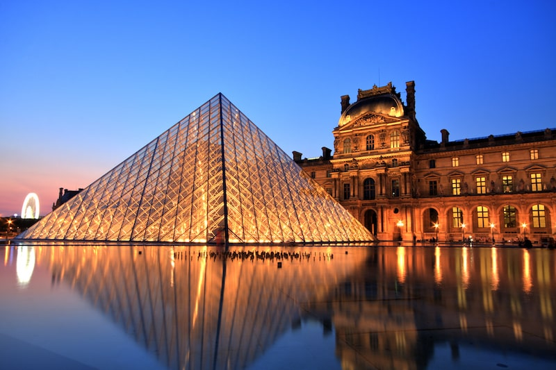 paris the louvre at night sunset sustainable travel
