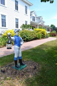 the coffey house b & b jockey statue exterior east marion north fork - East End Taste Magazine
