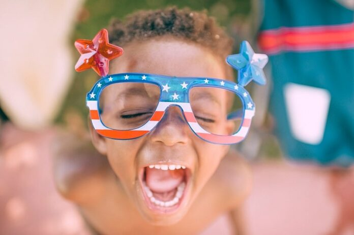 young boy celebrating fourth of july festive glasses independence day