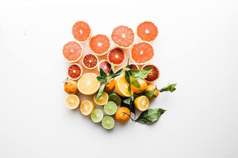 sliced lemons grapefruit limes white background