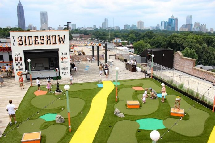 mini golf outside with city scape in the background