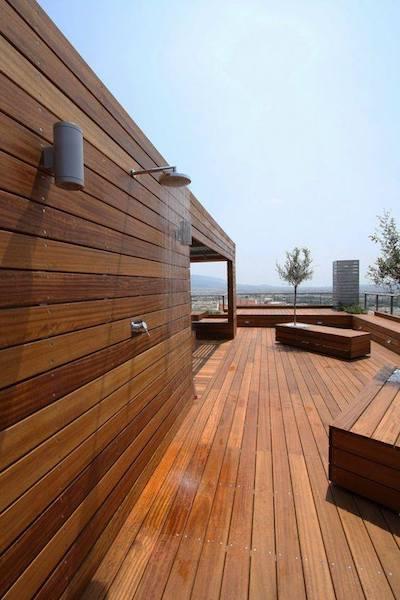 outdoor wooden deck space outdoor shower blue sky