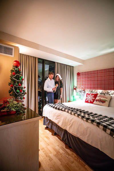 radission blu hotel couple celebrating christmas in their hotel room festive