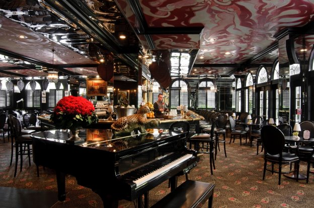 grand piano in restaurant bar with leopard red flowers black decor