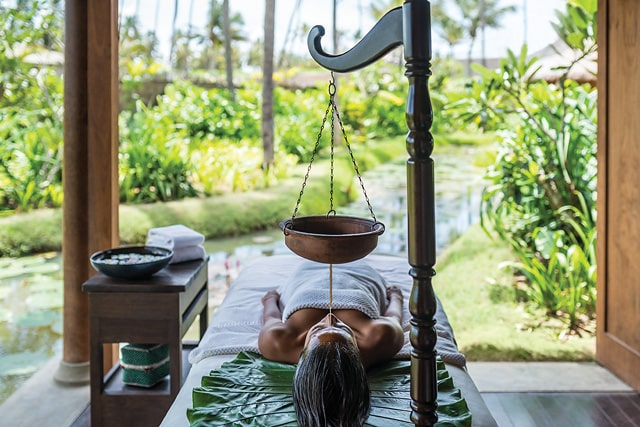woman getting an Ayurvedic spa treatment