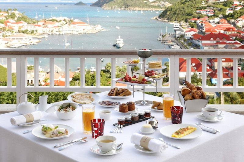 breakfast white tablecloth overlooking water in st. barth