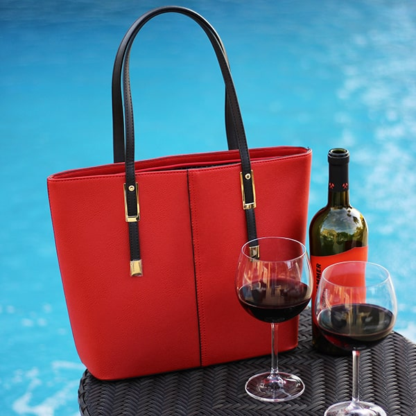 portovino wine purse classic red by pool with glasses of red wine - East End Taste Magazine