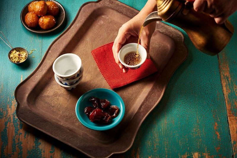 arabic coffee with dates and chocolate flat lay
