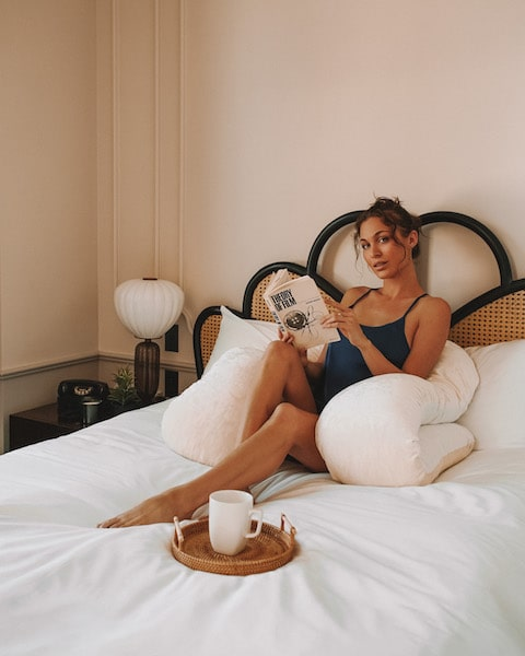 yana pillow woman with white cup of coffee bed