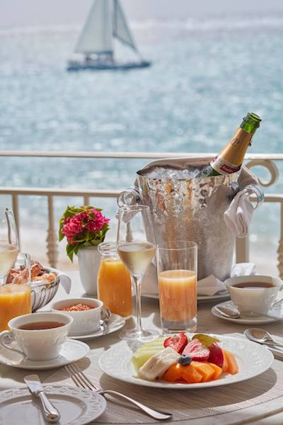 champagne breakfast deck patio overlooking water sailboat
