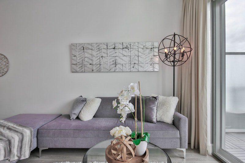 living room with sliding glass door purple sofa luxury Hamptons