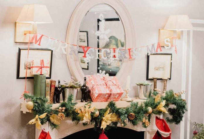 merry christmas banner with lights and mirror above fireplace white - East End Taste Magazine