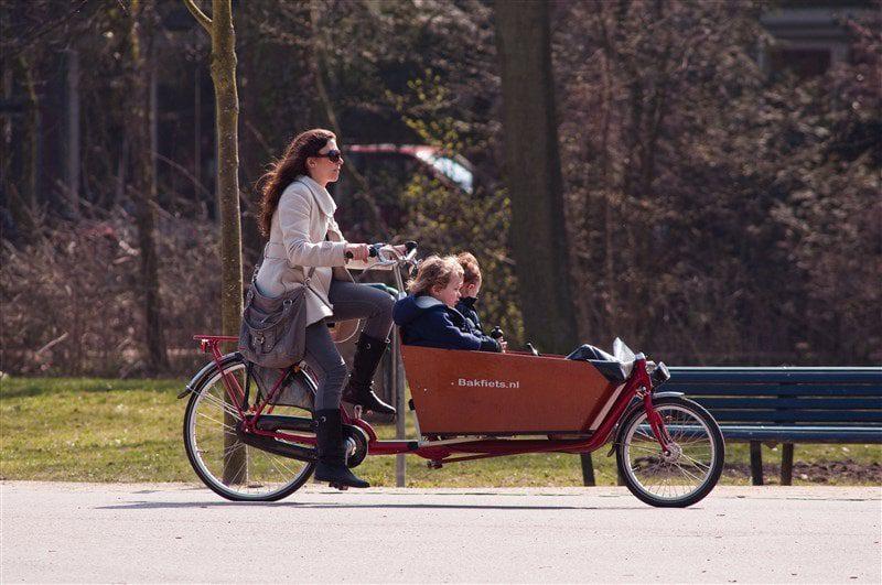Women and children biking in Amsterdam
