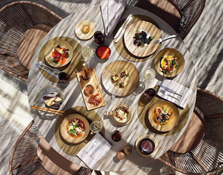 ikos aria sustainable resort greece earth day oliva restaurant
