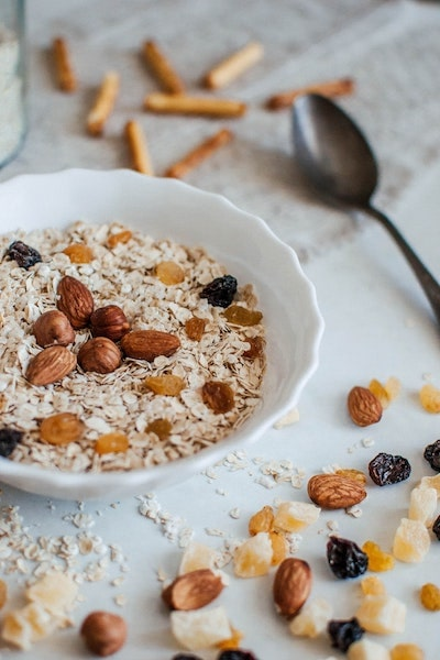 delicious nutrition breakfast cereal with almonds dried fruit