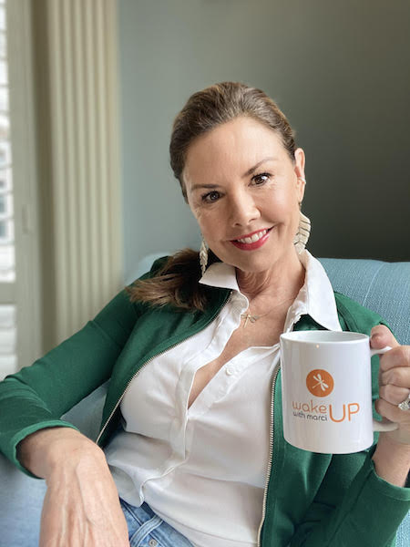 wake up with marci marci hopkins holding coffee mug