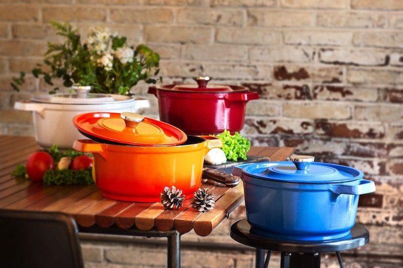 dutch oven set orange red blue in kitchen