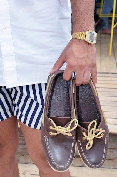 man holding sherry shoes summer hamptons