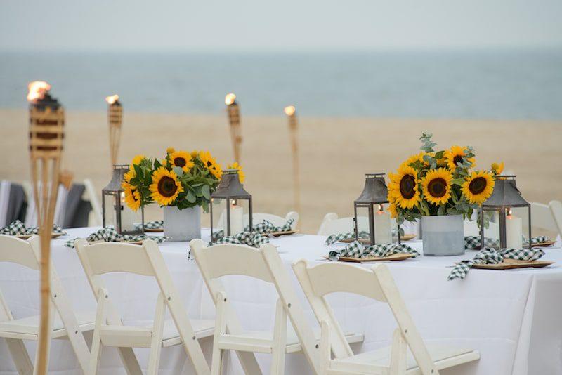 private beach dinner event sunflowers the hamptons