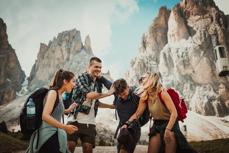 group of friends traveling mountain hiking backpacks