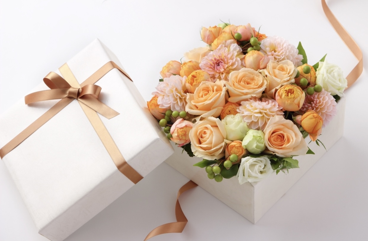 flower box birthday present white box gold bow