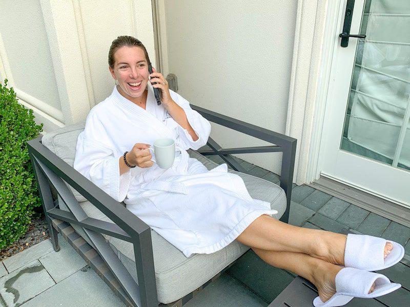 Vanessa Gordon in a white bathrobe on the cellphone
