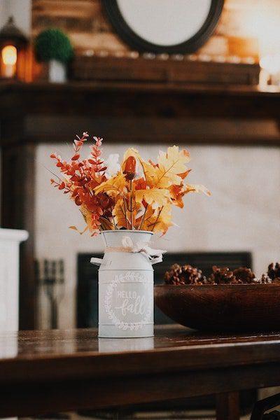 festive holiday decor home autumn leaves in white vase