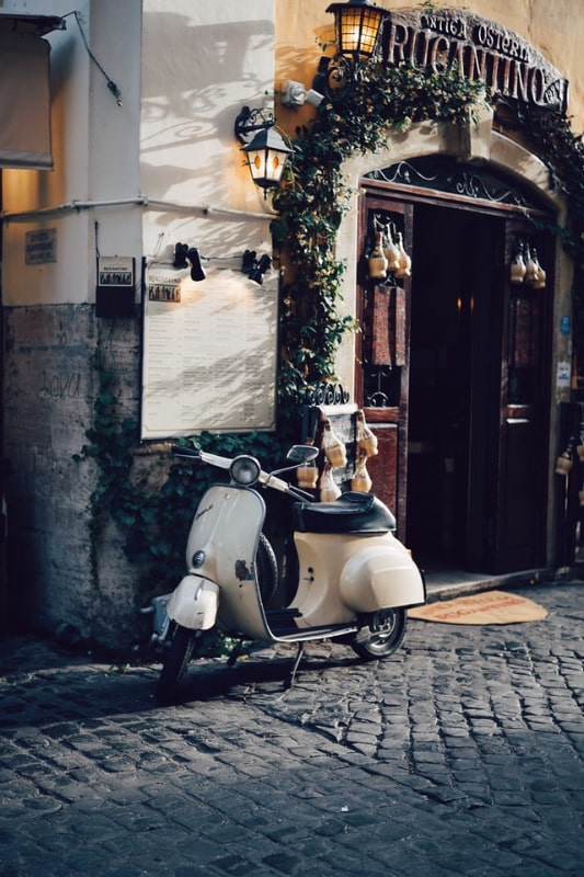 naples italy motor scooter cobble street